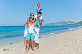 Family having fun on beach — Stock Photo