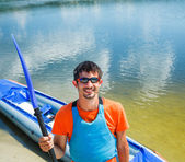 Man paddling a kayak — Stock Photo