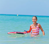 Cute girl with surfboard — Photo