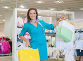Young pregnant woman in shop store — Stock Photo