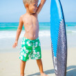 Boy has fun with the surfboard — Stock Photo #44712861