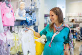 Pregnant woman in baby shop store — Stock Photo
