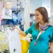 Pregnant woman in baby shop store — Stock Photo #44851627