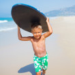 Boy has fun with the surfboard — Stock Photo #44851703