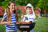 Kids having a barbecue party — Stock Photo