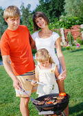 Family having barbecue — Stock Photo