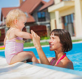 Family playing in swimming pool. — Stock Photo