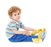 Boy with cute ducklings — Stock Photo