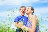 Kids with wild spring flowers — Stock Photo