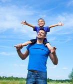 Happy father with son outdoors against sky — Stock Photo