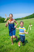 Kids in summer day holds windmill — Photo
