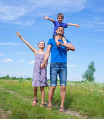 Happy father with kids outdoors against sky — Stock Photo