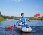 Young man kayaking — Stock Photo
