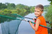 Little boy fishing — Stock Photo