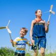 Kids in summer day holds windmill — Stock Photo #51190589