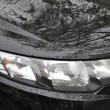 Head Lamp Of black Car - Stock Photo