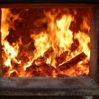 Firewood blaze in firebox — Stock Photo