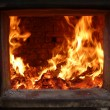 Stock Photo: Firewood blaze in firebox