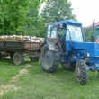 Stock Photo: Tractor bring firewood to house