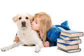 Girl kissing her Labrador retriever on isolated white — Stock Photo