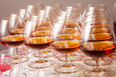 Glasses of cognac on festive table — Stock Photo