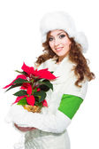 Beautiful girl with red poinsettia on isolated white — Stock Photo