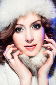 Beautiful girl with winter fur cap — Stock Photo
