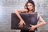 Beautiful girl with vintage suitcase waiting at the station — Stock Photo
