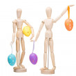 Two wooden little men with easter eggs on isolated white — 图库照片 #21794199