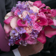 Wedding bouquet for bride in hands of groom — Stock Photo