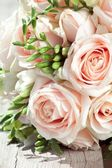 Wedding bouquet of white freesias and pink roses — Stock Photo