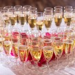 Glasses of champagne on festive table — Stock Photo #22605829