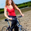 Beautiful woman with bicycle at the sea — Stock Photo #23816003