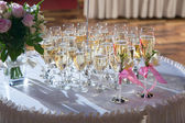 Decorated wedding glasses with champagne — Stock Photo