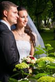 beautiful bride with groom — Stock Photo