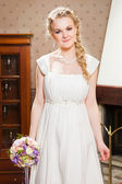 Beautiful bride near fireplace — Stock Photo