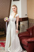 beautiful bride near fireplace — Стоковое фото