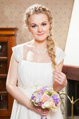 beautiful bride near fireplace — Stock fotografie