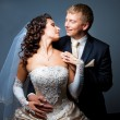Bride and groom embracing and looking at each other — Stock Photo #7279165