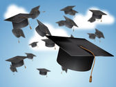 Graduation Caps Thrown in the Air — Stock Photo