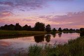 Soluppgång på floden i groningen — Stockfoto