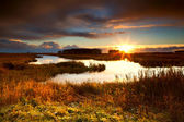 Dramatic sunrise over lake — Stock Photo