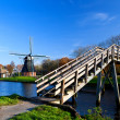 Dutch windmill and bridge — Stock Photo