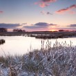 Sunrise over lake in winter — Stock Photo