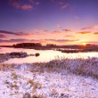 Dramatic sunrise over frozen lake — Stock Photo