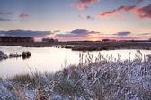 Sunrise over lake in winter — Stock Photo