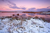 Snow by lake at sunrise — Stock Photo