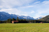 Wooden hut on alpine meadows in morning — Stock Photo