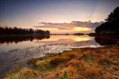 Dramatic sunset over lake — Stock Photo