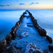 Old breakwater in North sea in dusk — Stock Photo #27888961